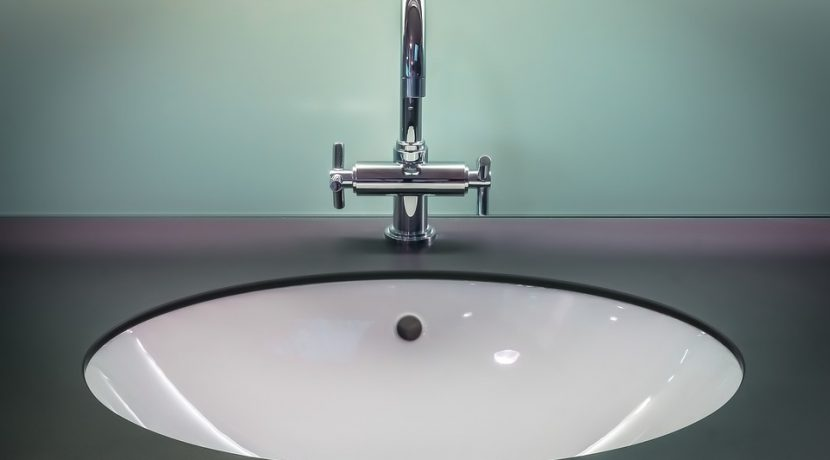 Can you use steel wool to remove stains from a fiberglass sink?