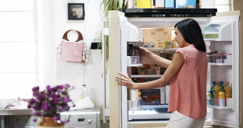 A Women Opening Refrigerator